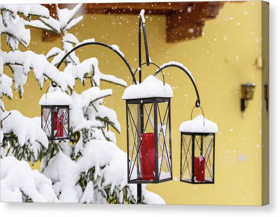 Fire Ball Canvas Print - In The Snow. Christmas Atmosphere by Nicola Simeoni