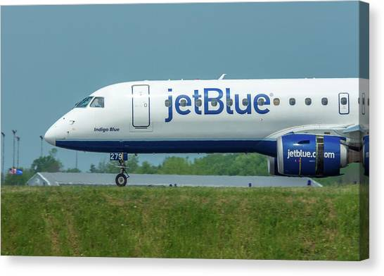 Jetblue Canvas Print - Indigo Blue by Guy Whiteley