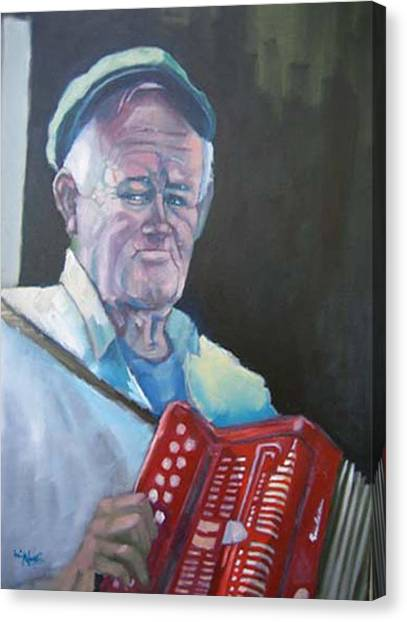 Inis Mor Accordian Player Canvas Print by Kevin McKrell