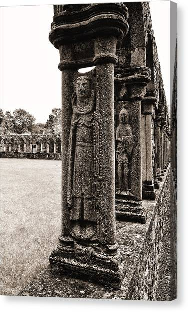 Canvas Print featuring the photograph Jerpoint Abbey Cloister Stone Figures by Menega Sabidussi