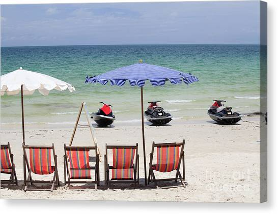 Jet Skis Canvas Print - Jet Ski And Deck Chair by Anek Suwannaphoom