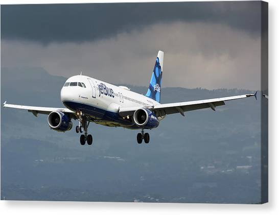 Jetblue Canvas Print - jetBlue A320 landing with mountain by Andres Meneses