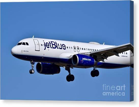 Jetblue Canvas Print - jetBlue Airlines plane in flight by Jeramey Lende