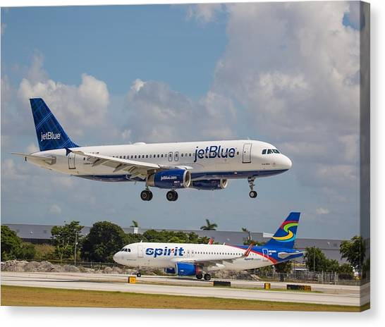 Jetblue Canvas Print - Jetblue Over Spirit Air by Dart and Suze Humeston