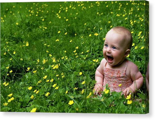 Joyful Baby In Flowers Canvas Print