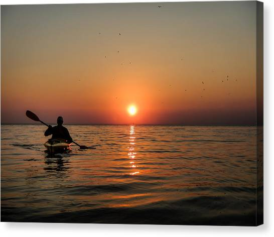 Kayak At Sunset Canvas Print