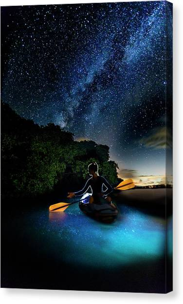 Kayak In The Biobay Under The Milky Way Canvas Print by Karl Alexander