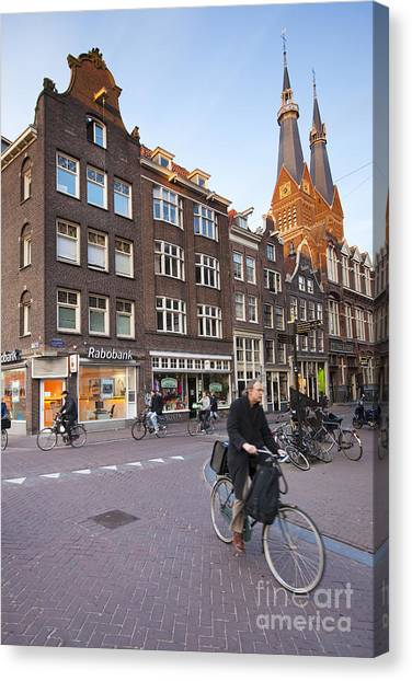 king a Walk in the Streets of Amsterdam Canvas Print by Andre Goncalves