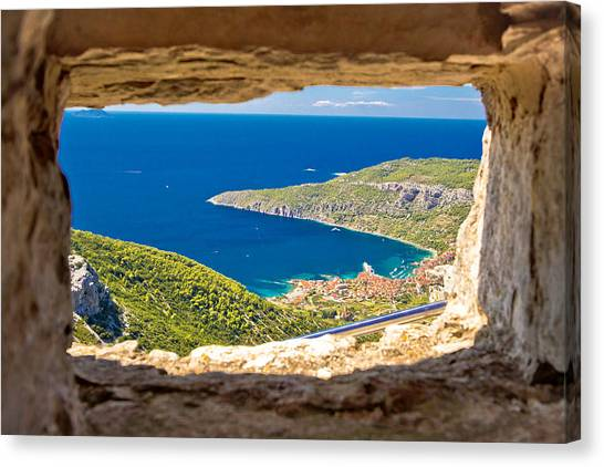 Komiza Bay Aerial View Through Stone Window Canvas Print