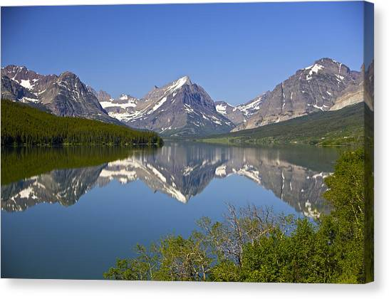 Lake At Many Glacier Canvas Print by Richard Steinberger