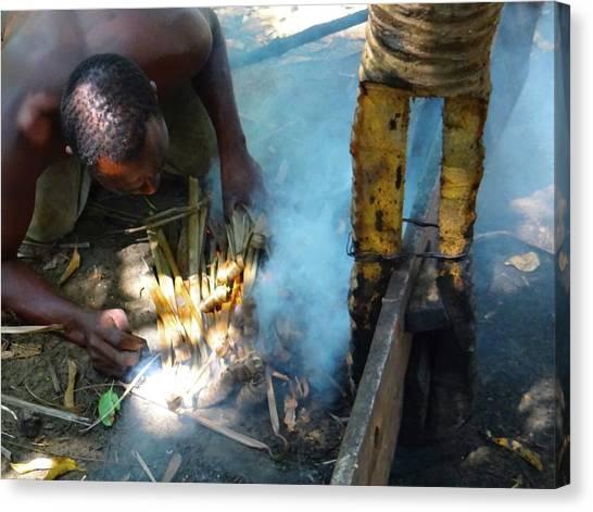 Exploramum Canvas Print - Lamu Island - Man Breathe Life Into A Fire 3 by Exploramum Exploramum