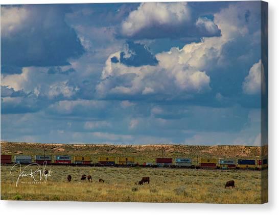Las Vacas Y El Tren Canvas Print by John Vigil