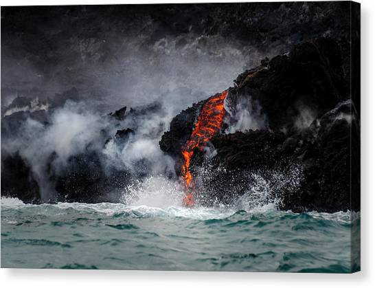 Lava Dripping Into The Ocean Canvas Print