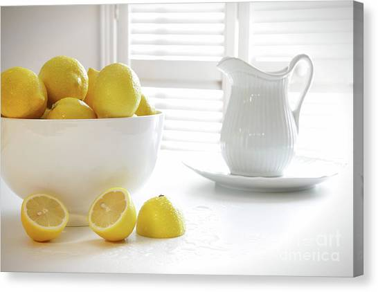 Lemons Canvas Print - Lemons In Large Bowl On Table by Sandra Cunningham
