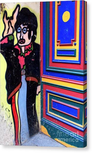 Lennon In Berlin Canvas Print by John Rizzuto