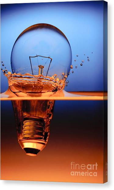 Glass Art Canvas Print - Light Bulb And Splash Water by Setsiri Silapasuwanchai