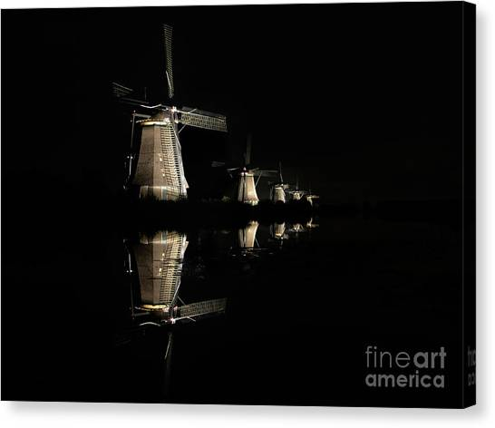 Lighted Windmills In The Black Night Canvas Print