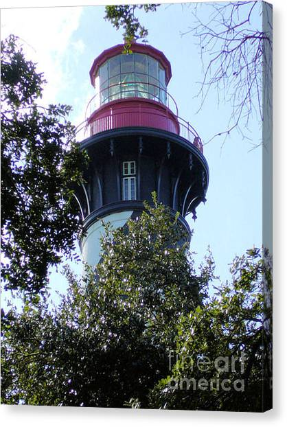 Lighthouse Among The Live Oaks Canvas Print by Barbara Oberholtzer