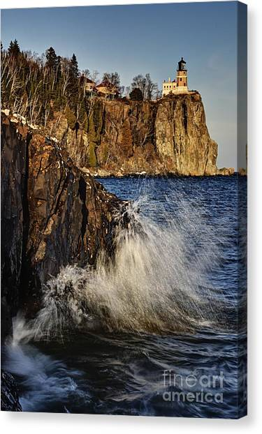 Lighthouse And Spray Canvas Print