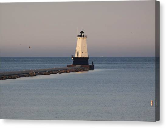 Lighthouse At Sunset Canvas Print by Chuck Bailey
