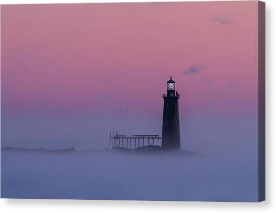 Lighthouse In The Clouds Canvas Print