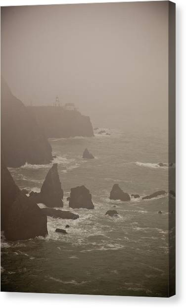Lighthouse In The Fog Canvas Print by Patrick  Flynn