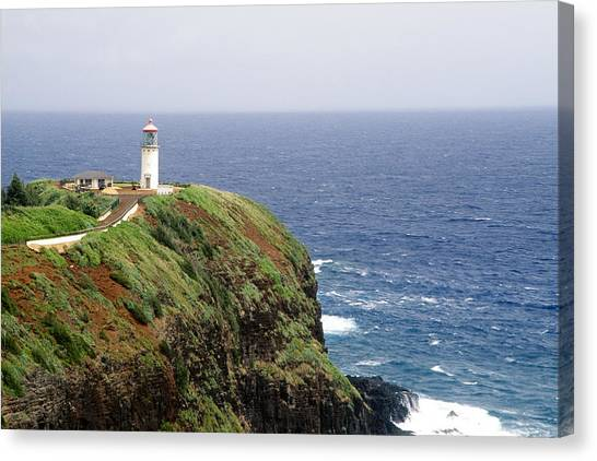 Lighthouse On A Cliff Kileaua Lighthouse Canvas Print by George Oze