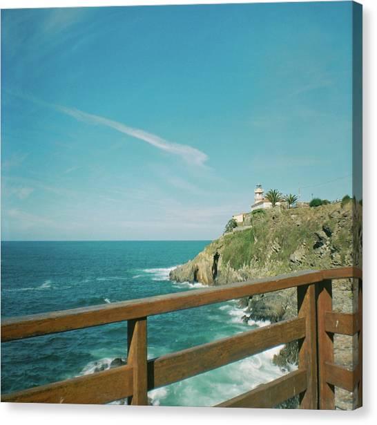 Lighthouse Over The Ocean Canvas Print
