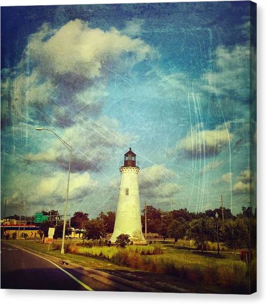 Lighthouses Canvas Print - #lighthouse #pascagoula #clouds by Joan McCool