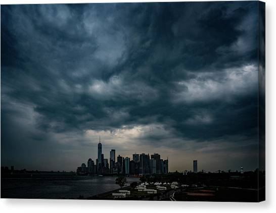 Canvas Print featuring the photograph Little Manhattan Under A Cloud by Chris Lord