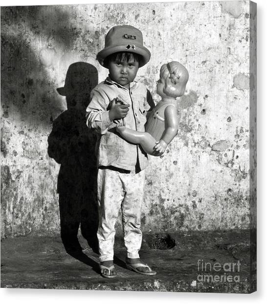 Little Vietnamese Girl Playing With Her Doll Canvas Print