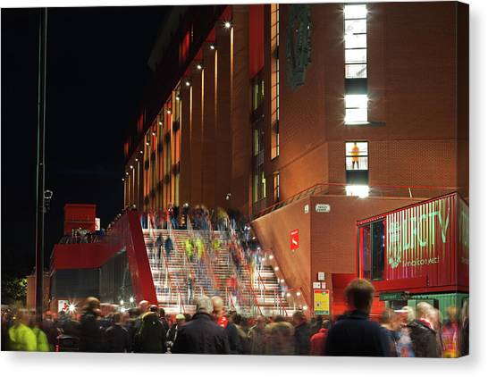 Liverpool Fc Canvas Print - Liverpool Uk 17 Th October 2016, Crowds Making Their Way Into The Stadium For A Night Match Against Manchester United by Ken Biggs