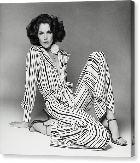 Lois Chiles Wearing A Striped Pajama And Blouse Canvas Print by Francesco Scavullo