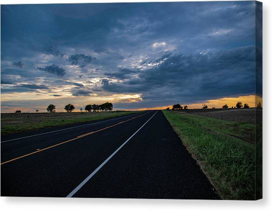 Lone Highway At Sunset Canvas Print