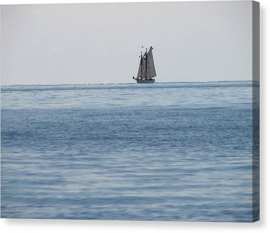 Lone Ship At Sea Canvas Print by Ginger Howland