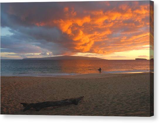Lone Surfer At Sunset Canvas Print by Stephen  Vecchiotti