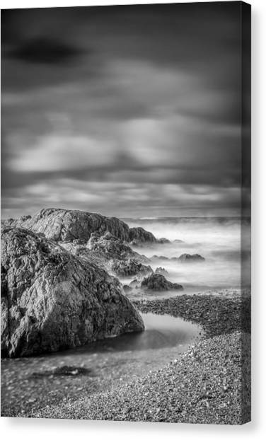 Long Exposure Of A Shingle Beach And Rocks Canvas Print