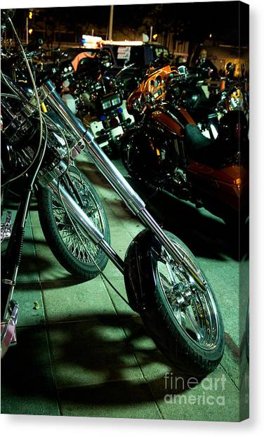 Long Front Fork And Wheel Of Chopper Bike At Night Canvas Print