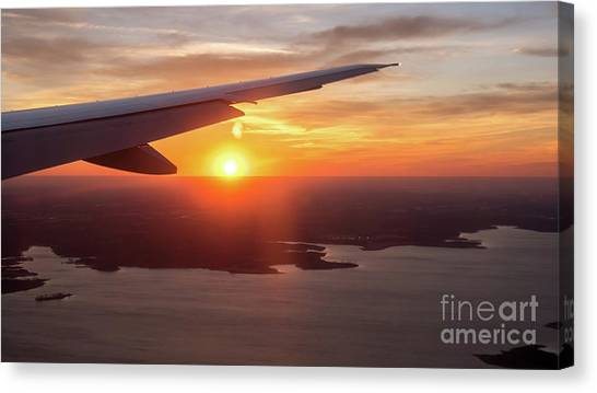 Looking At Sunset From Airplane Window With Lake In The Backgrou Canvas Print