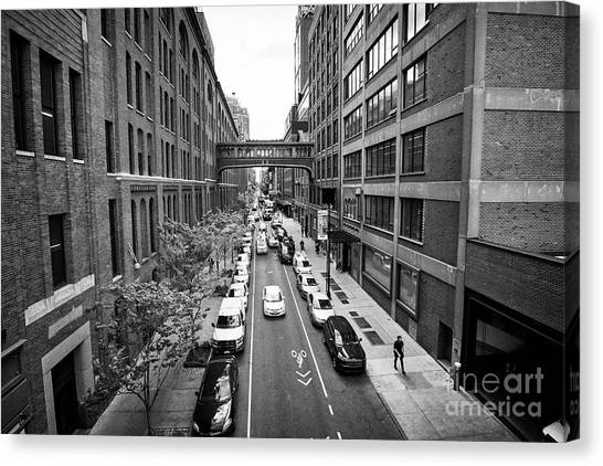 Nabisco Canvas Print - looking down west 15th street between chelsea market on the left and milk studios building New York  by Joe Fox