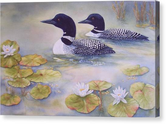 Loons In The Lilies Canvas Print by Cherry Woodbury