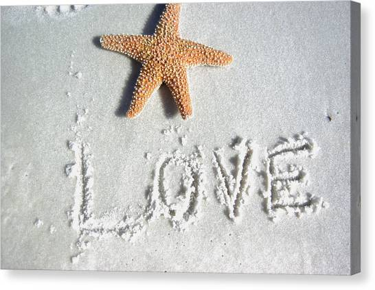 Love On The Sand Canvas Print