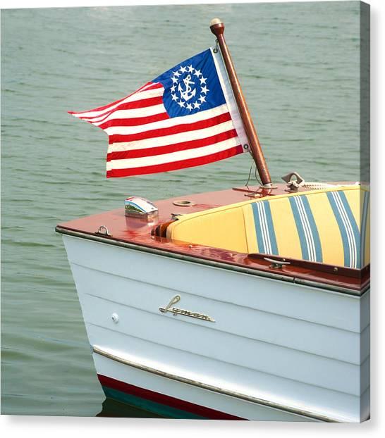Vintage Mahogany Lyman Runabout Boat With Navy Flag Canvas Print