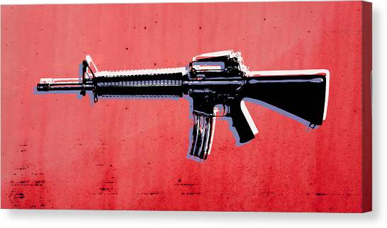 Rifles Canvas Print - M16 Assault Rifle On Red by Michael Tompsett
