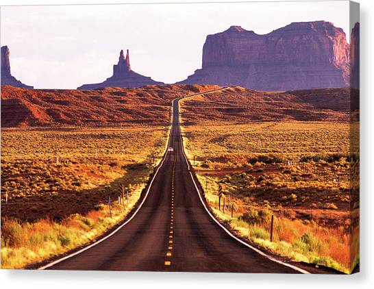 Magestic And Lonesome Road To Monument Valley Canvas Print by Kim Lessel