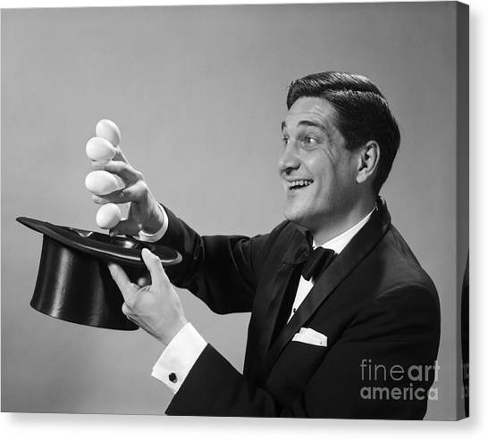 Hat Trick Canvas Print - Magician Pulling Eggs Out Of Hat by H. Armstrong Roberts/ClassicStock