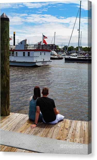 Man And Woman Sitting On Dock Canvas Print