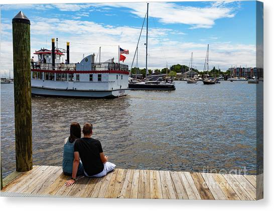 Man And Woman Sitting On The Dock Canvas Print