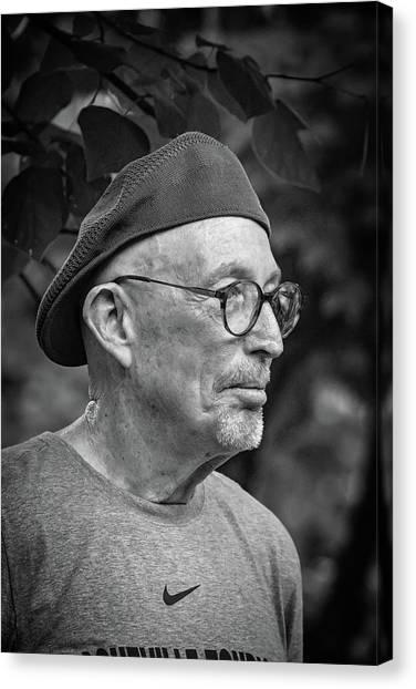 Man In A Nike Shirt Canvas Print by John Haldane