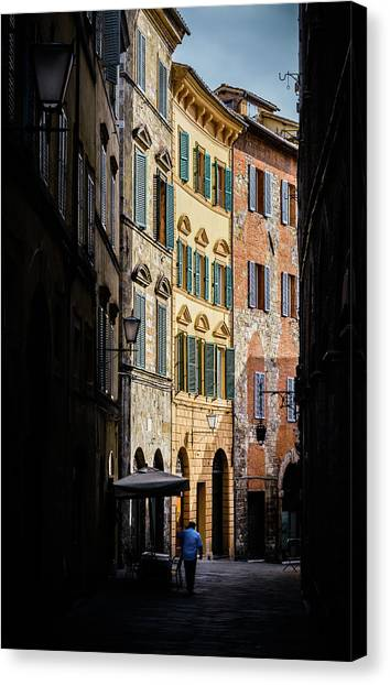 Man Walking Alone In Small Street In Siena, Tuscany, Italy Canvas Print